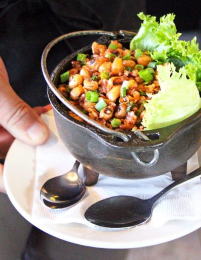 Close up of a southern inspired black eyed peas shareable lunch menu item being served at South Beach Grill